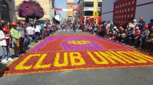 """One of the sawdust artworks on the street reads """"Club Union"""" the name of a local team."""