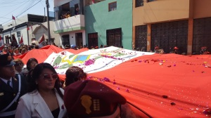 Another photo of the women of Tacna carrying the Peruvian flag.