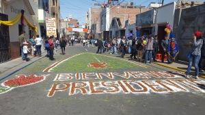 "A sawdust artwork reads ""Bienvenido President"" (Welcome President!)"