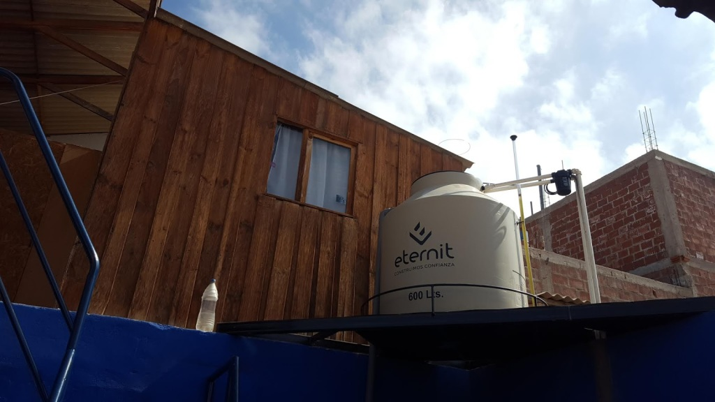A photo of our water tank on the second roof, made to hold six hundred liters.