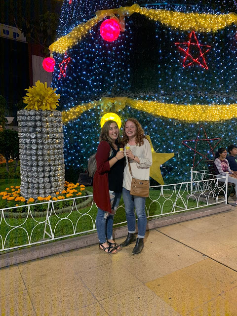 Maggie and I pose in front of the giant christmas tree with ice cream cones in hand.