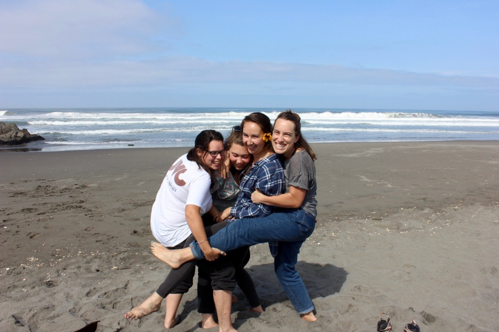 Faith, Hannah, Kristin and I hug each other and pose at the beach.